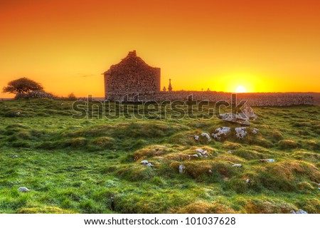 Ruins of old Irish chapel in Burren at sunrise