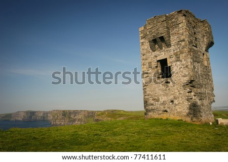 Ruins of old small castle at Cliffs of Moher, Ireland - stock photo
