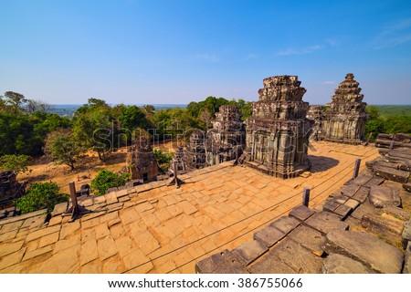 Ruins of Phnom Bakheng Temple at Angkor Wat complex, Siem Reap, Cambodia - stock photo