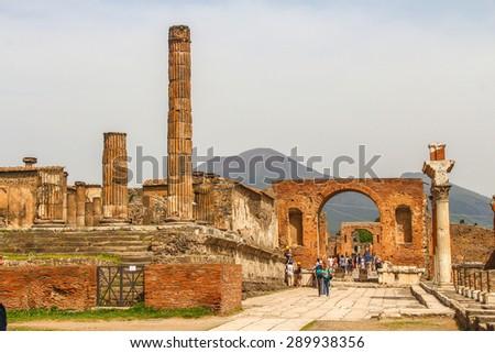 Ruins of Pompeii with Mount Vesuvius - stock photo