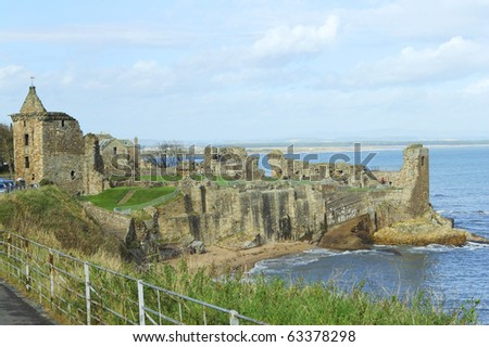 ruins of St. Andrews ancient castle with Angus coast in background - stock photo
