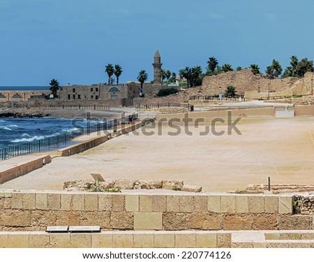 Ruins of the ancient hippodrome in Caesarea, Israel - stock photo