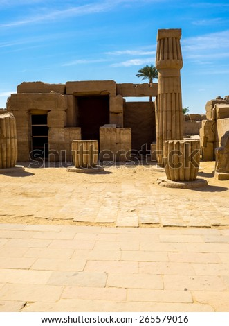 Ruins of the ancient temple of Egyptian civilization in Luxor. Travel to Egypt, landmarks of the ancient Thebes. Egyptian columns in Karnak Temple. - stock photo