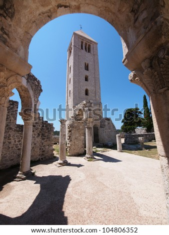 Ruins of the Church of St. John the Evangelist in Rab Croatia - a popular tourist attraction - stock photo