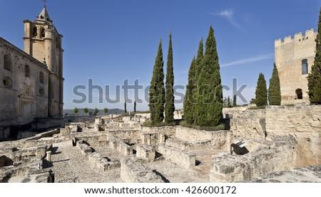 Ruins of the Fortaleza de La Mota with thw abbey and the alcazar tower in Alcala la Real, Spain - stock photo