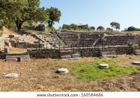 Ruins of the old amphitheater or amphitheatre in old city of Troy in Turkey - stock photo