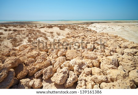 Ruins of the original trading post just a few hundred meters from Fort Al Zubarah in the northern Qatar desert, Middle East - stock photo
