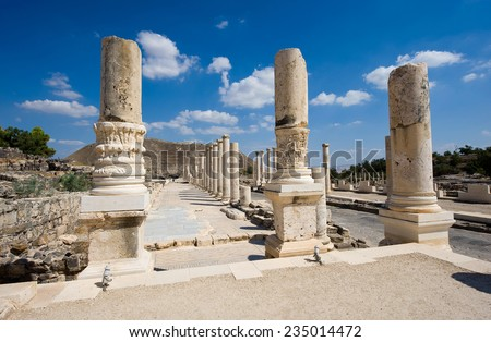 Ruins of the roman period in Beit She'An in Galilee in Israel, the hill on the background is the tell from the canaanite period - stock photo
