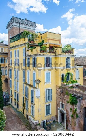 Ruins of Trajan's Forum in Rome, Italy are surrounded by newly built houses. - stock photo