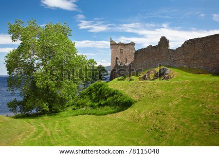 Ruins of Urquhart Castle near Loch Ness lake - stock photo