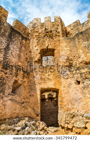 Ruins of  vintage defence tower of the ancient  Venetian fortress Frangokastello at summer sunny day.Crete island.District of Chania. Greece.Europe. - stock photo