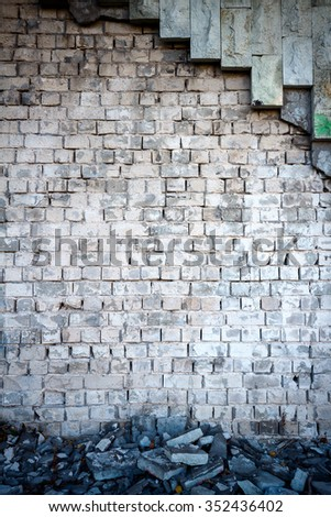 Ruins of white brick and stone tile wall - stock photo