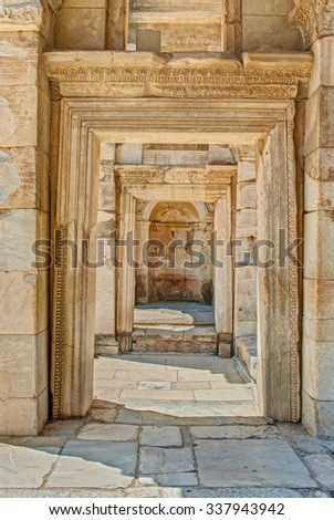 ruins or stone corridor with square archs near Celsus Library in Ephesus on sunny day, Turkey - stock photo