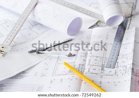 Ruler, eraser, glasses and a pencil on the floor plan - stock photo