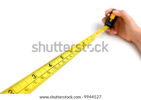 Ruler tool, focus on four inches - stock photo