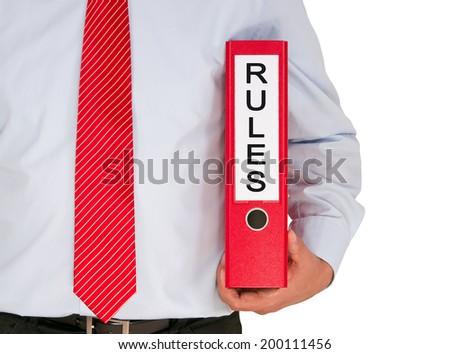 Rules - Businessman with Binder - stock photo