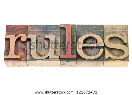 rules word  - isolated text in vintage letterpress wood type blocks stained by color inks