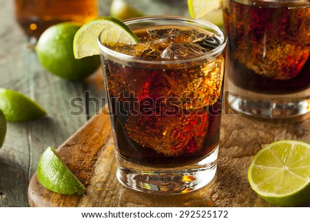 Rum and Cola Cuba Libre with Lime and Ice - stock photo