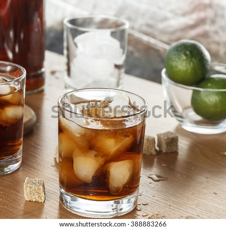 rum in a glass with ice, closeup