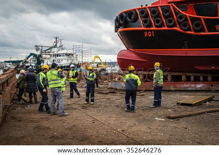 Rumelifeneri, Turkey - December 15, 2015: Men are working at the dock where they are doing preperation works for launching a new ship.