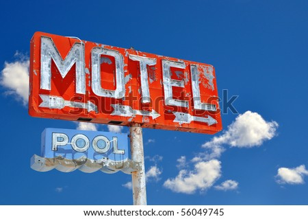 Run-down Motel Sign off of I-40. - stock photo