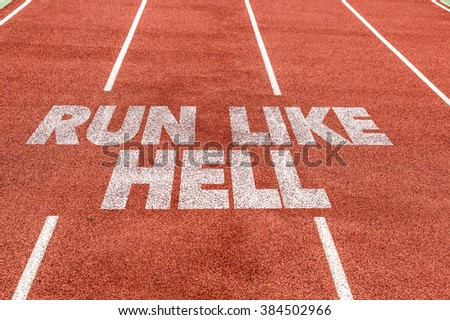 Run Like Hell written on running track