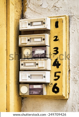 rundown old bell buttons at a wall - stock photo