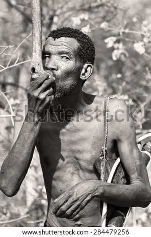 RUNDU, NAMIBIA - SEPT. 13, 2014: San People or Bushmen illustrating way of life in harsh desert environment (Namib Desert). Indigenous hunter-gatherer peoples of Africa.