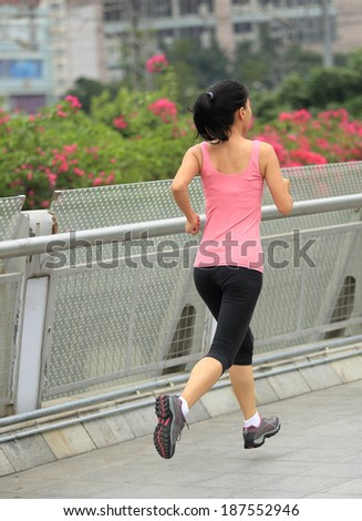 Runner athlete running at city. woman fitness jogging workout wellness concept.