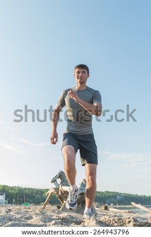 Runner athlete running at seaside. Man fitness morning jogging workout wellness concept