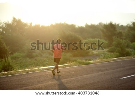 Runner athlete running at seaside. man fitness silhouette sunrise jogging workout wellness concept. - stock photo