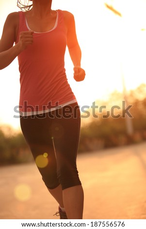 runner athlete running on road. woman fitness jogging workout wellness concept  - stock photo