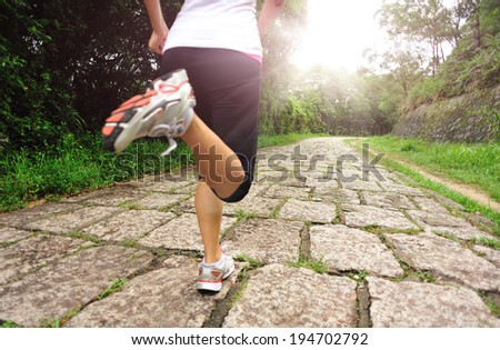 Runner athlete running on sunrise road. woman fitness jogging workout wellness concept.  - stock photo