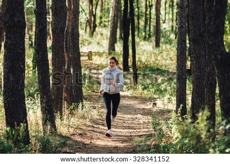 runner caucasian woman jogging in autumn park
