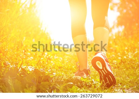 runner feet closeup. athlete in the park outdoors. running shoes. jogging. - stock photo