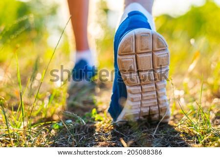 Runner feet running on road closeup on shoe - stock photo