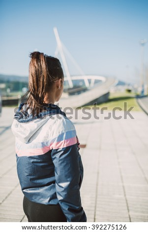 Runner female woman back outdoors with copy space on the right