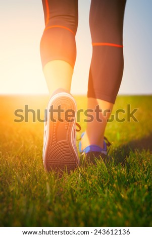 Runner girl - athlete running at seaside, woman fitness, healthy lifestyle