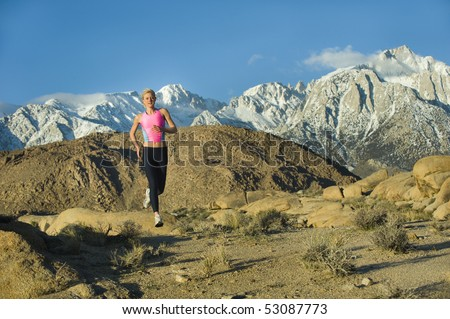 Runner in high mountains