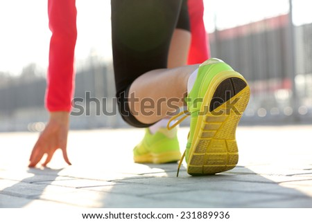 Runner in start position - stock photo