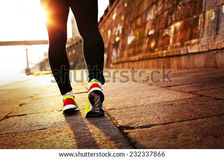 Runner in the sunlight - stock photo