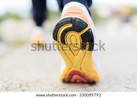 Runner Man Feet Running on Road closeup on shoe - stock photo