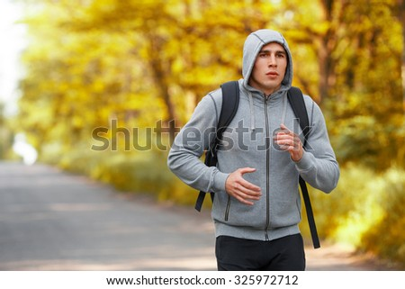 Runner man running on road training sprint. Sporting male run working out, outside - stock photo