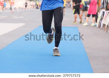 Runner marathon running to finish line.Marathon running. - stock photo