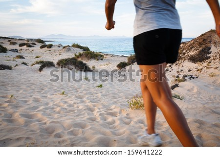 Runner on beach - stock photo