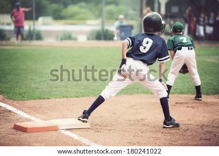 Runner on first base - stock photo