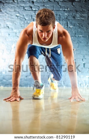 Runner on start. Focus on face. - stock photo