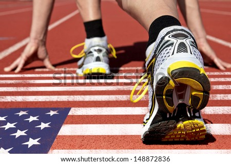 Runner on US flag waits for his start - stock photo