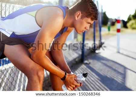 Runner resting after run - stock photo