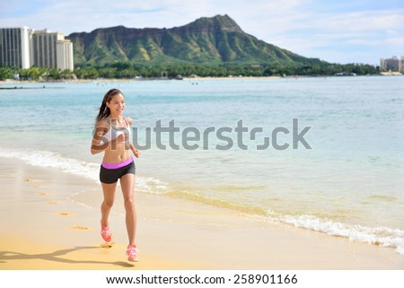 Runner - Sport running fitness woman jogging on beach run Female athlete jogger training living healthy active exercise lifestyle exercising outdoor on Waikiki Beach, Honolulu, Oahu, Hawaii, USA. . - stock photo